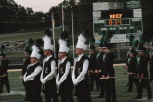 The drum majors and the band waiting on director Harold Yankey to lead the national anthem. Photo by Presley Vanover