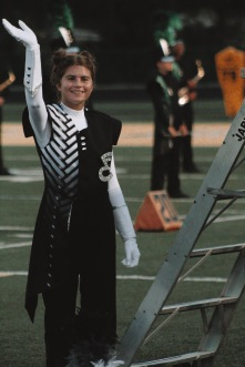 Drum major Stephanie Combs waves as she's introduced to the crowd. Photo by Presley Vanover