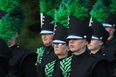 Band members stay focused while marching down to the field. Photo by Tori Ables