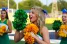 Senior Kristen Winchell shakes her pom-poms together as she helps lead a chant for the student section. Photo by Grace Allen.