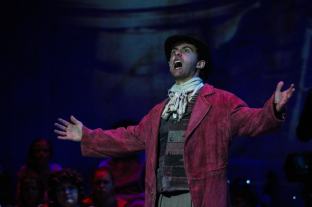 Junior Hunter Marlow, who plays Bill Sikes, sings in FC Theatre Arts production of Oliver! Photo by Mary Ficker.
