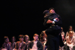 Junior Tre Gaines and fourth grader Lincoln Fogarty share a hug at the end of FC Theatre Arts production of Oliver! Photo by Mary Ficker.