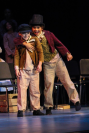 Oliver, fourth grader Lincoln Fogarty, and the Artful Dodger, fifth grader Zander Essex, mess around on stage during a run of Oliver! at FC. Photo by Mary Ficker.