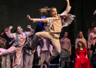 Eighth grader Emma Hockensmith does a bell kick during one of the dance numbers on FC Theatre Arts production of Oliver! Photo by Mary Ficker.