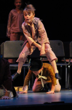 Fourth grader Brady Ross jumps over fourth grader Lincoln Fogarty during one of the dance numbers in FC Theatre Arts production of Oliver! Photo by Mary Ficker.