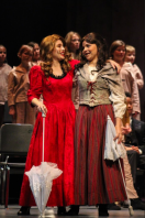 Senior Isabella Arnett and junior Raven Prentiss sing to each other during a run of FC Theatre Arts production of Oliver! Photo by Mary Ficker.