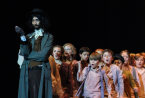 Fagin, played by senior Jack Meriwether, stands in front of the dancing pickpockets during a run of FC Theatre Arts production of Oliver! Photo by Mary Ficker.