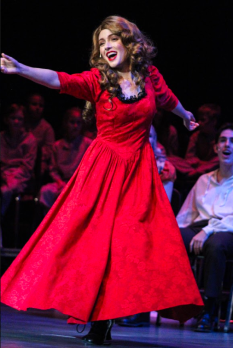 Nancy, played by senior Isabella Arnett, turns and sings to the audience while dancing during a run of Oliver! at FC. Photo by Mary Ficker.