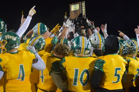 The Highlanders hold up the winning Sectional Championship Title Trophy after winning 31-7 against Jeffersonville. Photo by Kate Zuverink.