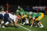 The Highlanders offensive line take positions to start the next play. Photo by Kate Zuverink.