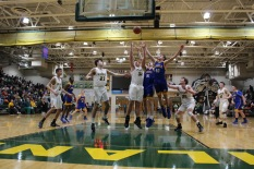 Senior Grant Gohmann blocks the Knights from getting the basketball. Photo by Kate Zuverink.