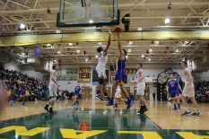 Freshman Caleb Washington jumps to block the Knights from getting a basket. Photo by Kate Zuverink.