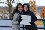 Senior Macie Stockton and junior Caroline Siegrest pose for a photo while checking participants for the Miles for Merry Miracles Run on Saturday, Nov. 23. Photo by Mary Ficker.