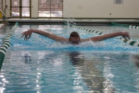 As his wingspan reaches almost the entire lane width, Dalton Lawver pushes the water with his body as he swims butterfly. Photo by Grace Allen.