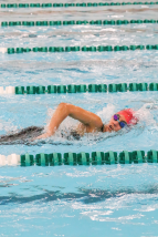 Freshman Mia Cochran swims freestyle during her heat of the 2020 Hoosier Hills Conference sectional on Feb. 8. Photo by Brock Kennedy.
