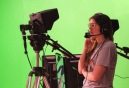 Junior Shelby Stamper watches through the camera as her fellow classmates rehearse for the FCTV live show. Photo by Mary Ficker.