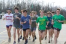 The boys' long distance track team jogs at the start of their run after school. Photo by Grace Allen.