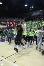 Seniors Seth Burks and Grant Gibson chest bump after winning sectionals. Photo by Brock Kennedy.