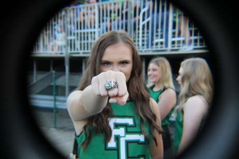 "Senior Abby Hart shows off her ring during a football game. Reminiscing on her last year of high school Hart opens up about her feelings during this crazy time. ""I wish I could say goodbye the way I wanted to on May 29. The class of 2020 got unlucky in a lot of ways, but this is the class nobody will forget,"" said Hart. Photo by Sophia Perigo."