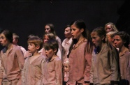 """The children's ensemble of FC Theatre Arts production of Oliver sings """"Food Glorious Food"""" during a tech rehearsal. Oliver was performed on October 25, 26, and 27 of 2019. Photo by Mary Ficker."""