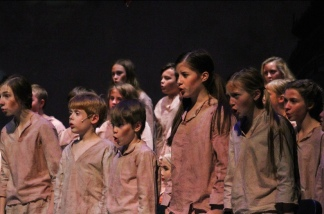 "The children's ensemble of FC Theatre Arts production of Oliver sings ""Food Glorious Food"" during a tech rehearsal. Oliver was performed on October 25, 26, and 27 of 2019. Photo by Mary Ficker."