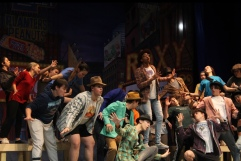 """Junior Tre Gaines sings """"Sit Down, You're Rockin' the Boat"""" during a rehearsal. Photo by Tori Ables."""