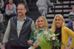 Senior Dazzler Olivia Taylor's parents escort her to center court where she poses for the camera during senior night at the FC basketball game. Photo by Matt Bolus.