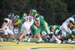 Junior Zen Michalski pushes a player while defending the ball to get a touchdown at theVincennes Lincoln game on Friday, September 6, 2019. Photo by Kate Zuverink.