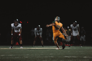 """Senior Cole Hussung swings his leg back to make the field goal against revival, New Albany High School. """"We beat them every single year,"""" said Hussung. Photo by Presley Vanover."""