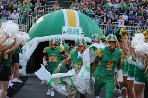 The FC football team rushes onto the field before one of the very first home games of the season on September 6. Photo by Brooke Miller.
