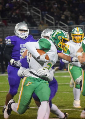 Junior Wenkers Wright runs the ball down the field while dodging the Panthers to get a touchdown at the Bloomington South Regional game on November 15, 2019. Photo by Kate Zuverink.